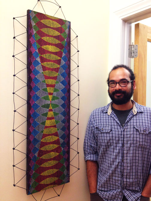 Victor Palomino with his artwork